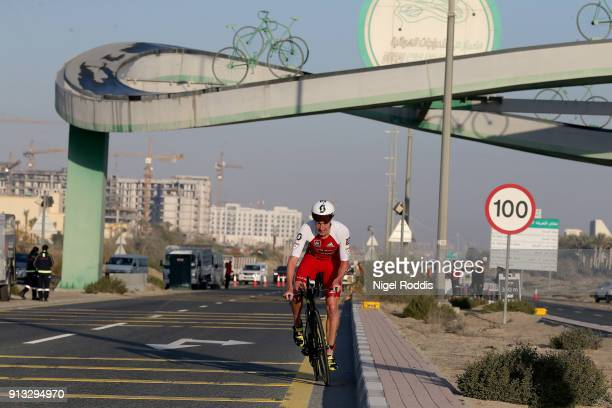 Alistair Brownlee of Britain competes in the bike section of Ironman 703 Dubai on February 2 2018 in Dubai United Arab Emirates