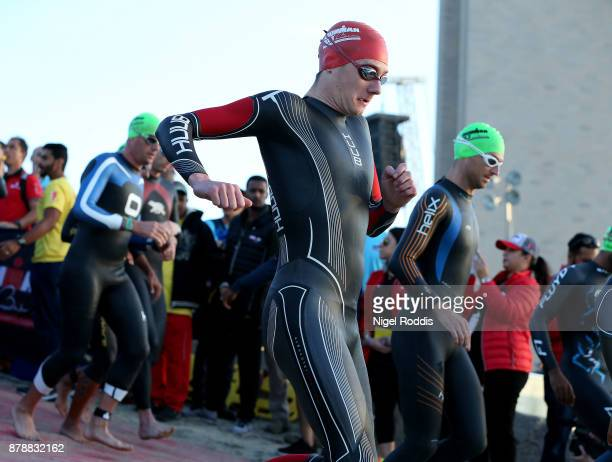 Alistair Brownlee of Britain competes in the swim section of Ironman 703 Middle East Championship Bahrain on November 25 2017 in Bahrain Bahrain