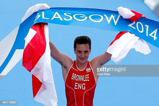 Alistair Brownlee of England celebrates as he crosses the line to take victory for England in the mixed team relay Triathlon at Strathclyde Country...