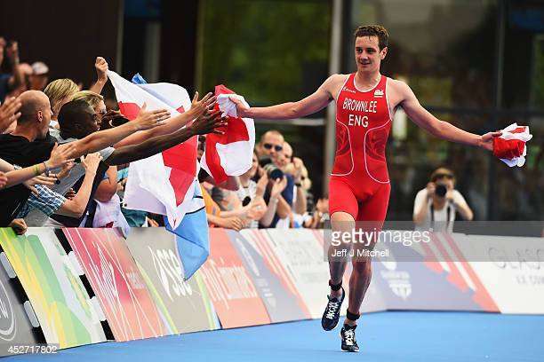Alistair Brownlee of England celebrates as he reaches the finish line to win gold in the Triathlon Mixed Team's Relay Final at Strathclyde Country...