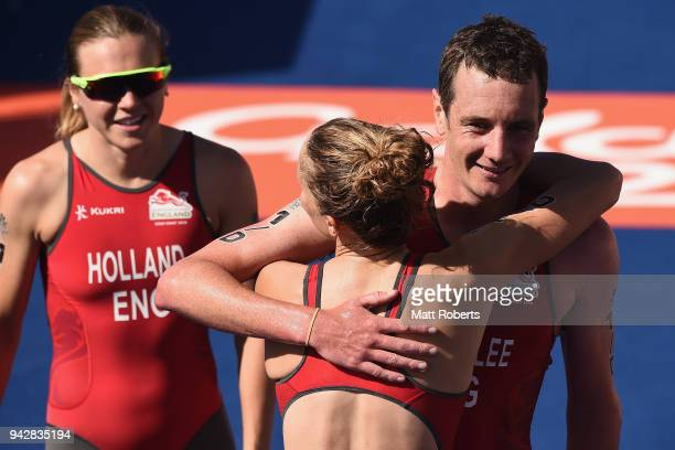 Alistair Brownlee of England celebrates with team mates Jessica Learmonth and Vicky Holland after winning Silver in the Triathlon Mixed Team Relay on...