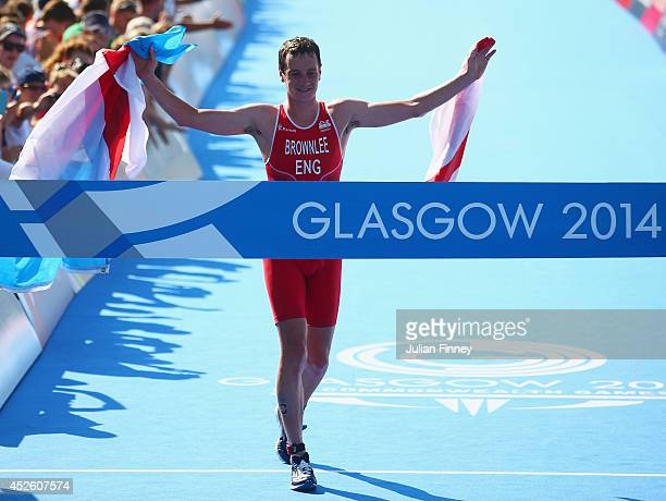Alistair Brownlee of England crosses the line to win gold in the Men's Triathlon at Strathclyde Country Park during day one of the Glasgow 2014...