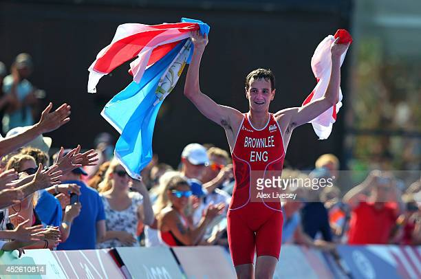 Alistair Brownlee of England on his way to winning gold in the Men's Triathlon at Strathclyde Country Park during day one of the Glasgow 2014...