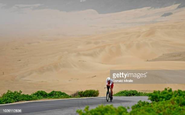 Alistair Brownlee of Great Britain bikes in fron of the sand dunes during the Isuzu IRONMAN 703 World Championship Men on September 2 2018 in Port...