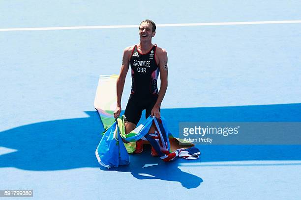 Alistair Brownlee of Great Britain celebrates after crossing the finish line during the Men's Triathlon at Fort Copacabana on Day 13 of the 2016 Rio...