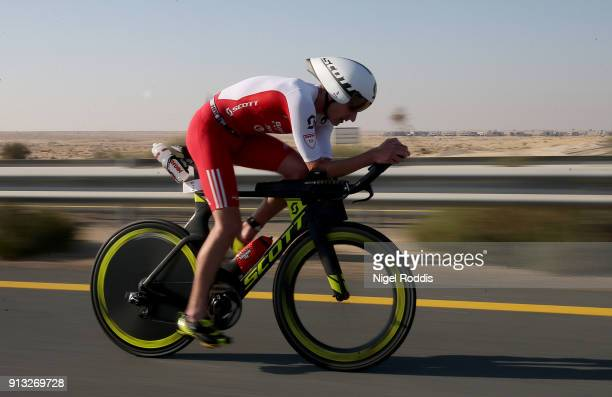 Alistair Brownlee of Great Britain competes in the bike section of Ironman 703 Dubai on February 2 2018 in Dubai United Arab Emirates