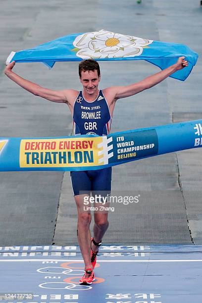 Alistair Brownlee of Great Britain crosses the finish line during the 2011 ITU World Championship Grand Final at Shisanling Reservoir on September 10...
