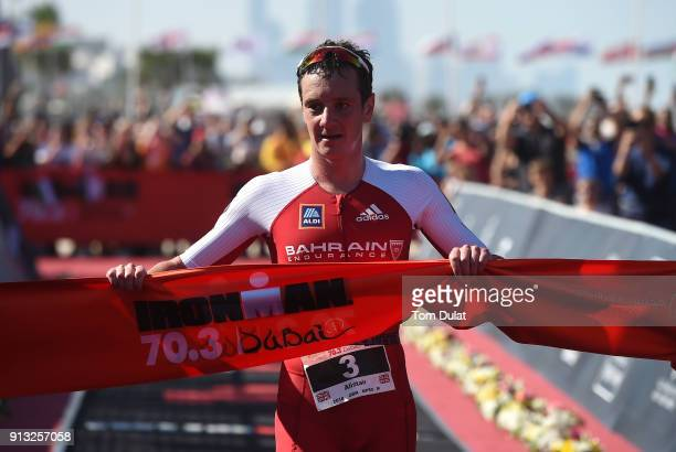 Alistair Brownlee of Great Britain crosses the finish line to win the Ironman 703 Dubai 2018 on February 2 2018 in Dubai United Arab Emirates