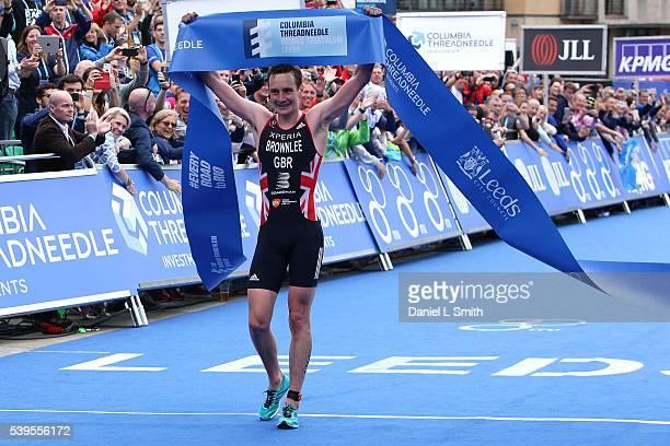 Alistair Brownlee of Great Britain crosses the line to win the 2016 ITU World Triathlon Leeds on June 12 2016 in Leeds England