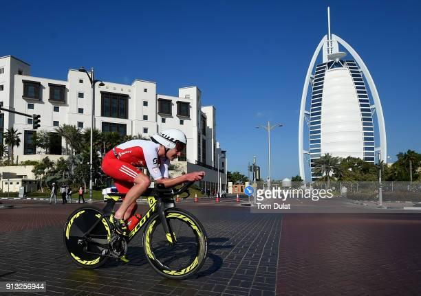 Alistair Brownlee of Great Britain cycles past Burj Al Arab during the Ironman 703 Dubai 2018 on February 2 2018 in Dubai United Arab Emirates