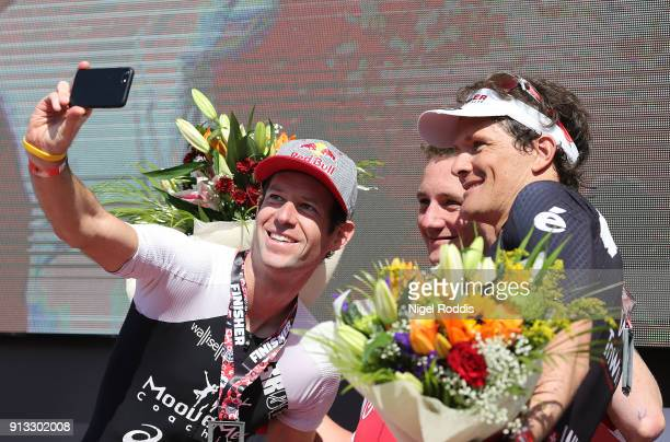 Alistair Brownlee of Great Britain First Sven Riederer of Switzerland Second and Ruedi Wild of Switzerland Third take a selfie on the podium after...
