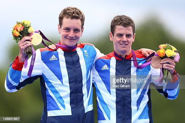 Alistair Brownlee of Great Britain poses with his gold medal next to his brother and bronze medalist Jonathan Brownlee of Great Britain during the...