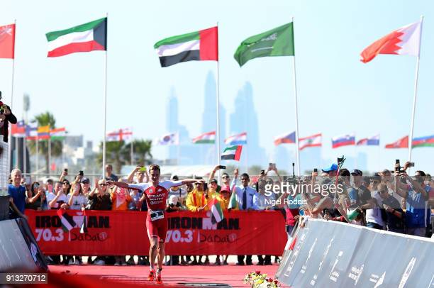 Alistair Brownlee of Great Britain reacts after winning Ironman 703 Dubai on February 2 2018 in Dubai United Arab Emirates