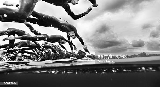 Alistair Brownlee of Team GB and other competitors dive in for the start of the Men's Triathlon on Day 11 of the London 2012 Olympic Games at Hyde...