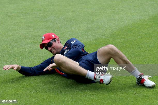 Alistair Cook of Essex struggles to his feet during warmup prior to the Royal London OneDay Cup between Kent and Essex at the Spitfire Ground on May...