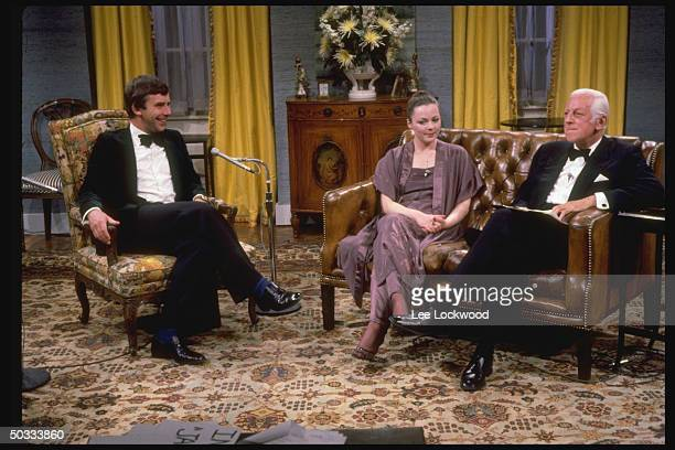 Alistair Cooke host of the TV series Upstairs Downstairs sitting on set of Boston station WGBH w Jacqueline Tong and Chris Beeny for farewell...