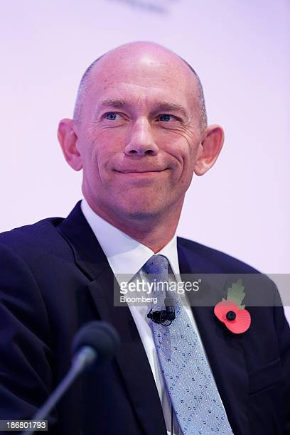 Alistair Cox chief executive officer officer of Hays Plc reacts during the Confederation of British Industry's annual conference in London UK on...