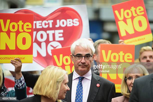 Alistair Darling leader of the Better Together meets with members of the public during a walk about on September 15 2014 in Kilmarnock Scotland With...