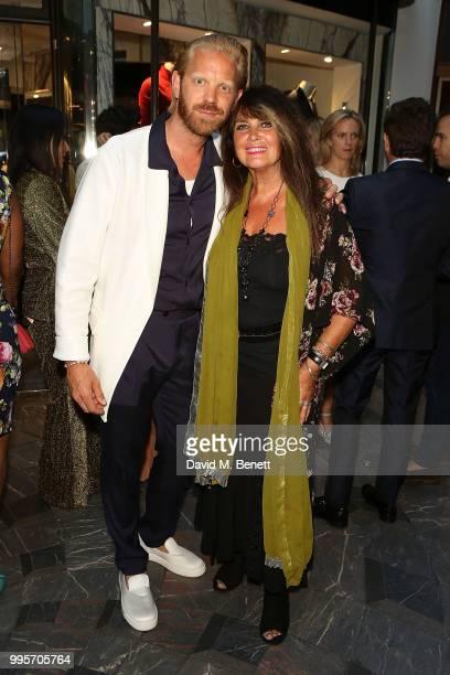 Alistair Guy and Caroline Munro attend the La Perla x Alistair Guy The Ultimate Summer Wardrobe party at La Perla Burlington Arcade on July 10 2018...