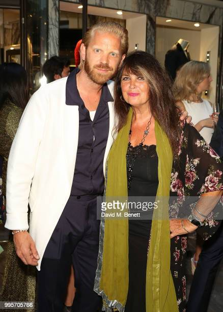 Alistair Guy and Caroline Munro attend the La Perla x Alistair Guy 'The Ultimate Summer Wardrobe' party at La Perla Burlington Arcade on July 10 2018...
