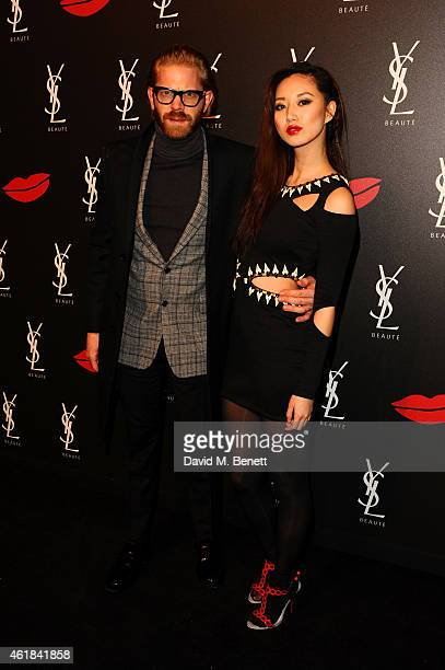 Alistair Guy and guest attend the YSL Beaute Makeup Celebration 'YSL Loves Your Lips' in the presence of Cara Delevingne at The Boiler House The Old...