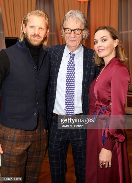 Alistair Guy Sir Paul Smith and Victoria Pendleton attend Paul Smith Womens Tuxedo Launch at the Italian Embassy on November 28 2018 in London England