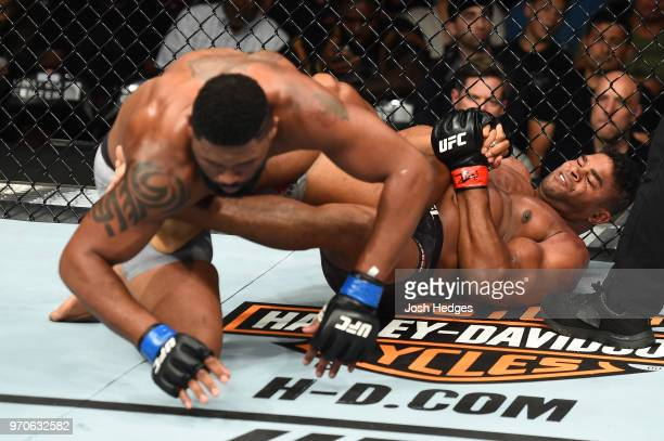 Alistair Overeem attempts a heel hook against Curtis Blaydes in their heavyweight fight during the UFC 225 event at the United Center on June 9 2018...