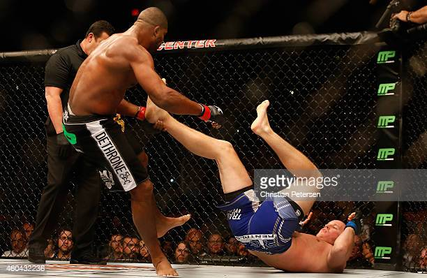 Alistair Overeem avoids kicks from Stefan Struve in their heavyweight bout during the UFC Fight Night event at the at US Airways Center on December...