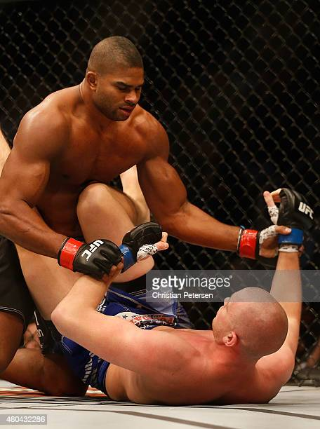 Alistair Overeem grapples with Stefan Struve in their heavyweight bout during the UFC Fight Night event at the at US Airways Center on December 13...