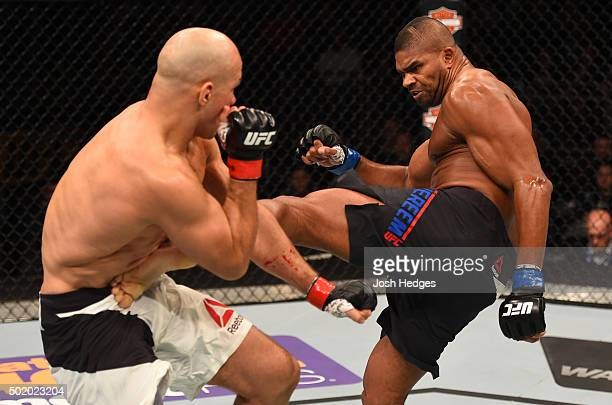 Alistair Overeem kicks Junior dos Santos in their heavyweight bout during the UFC Fight Night event at the Amway Center on December 19 2015 in...