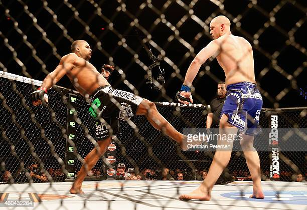 Alistair Overeem kicks Stefan Struve in their heavyweight bout during the UFC Fight Night event at the at US Airways Center on December 13 2014 in...