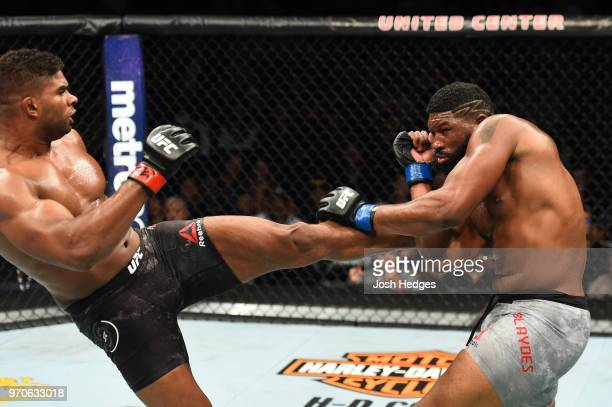 Alistair Overeem kicks the body of Curtis Blaydes in their heavyweight fight during the UFC 225 event at the United Center on June 9 2018 in Chicago...