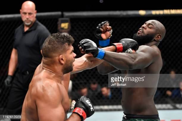Alistair Overeem of Netherlands punches Jairzinho Rozenstruik of Suriname in their heavyweight bout during the UFC Fight Night event at Capital One...
