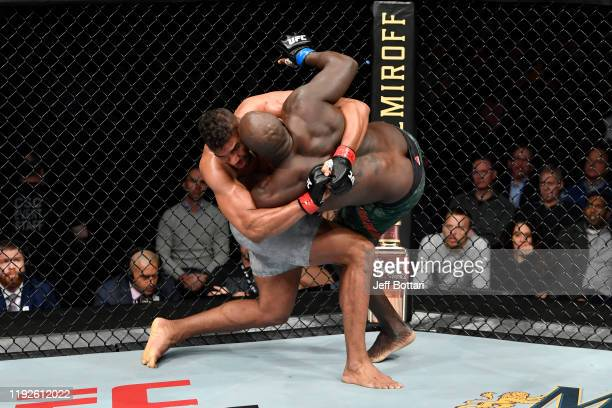 Alistair Overeem of Netherlands takes down Jairzinho Rozenstruik of Suriname in their heavyweight bout during the UFC Fight Night event at Capital...