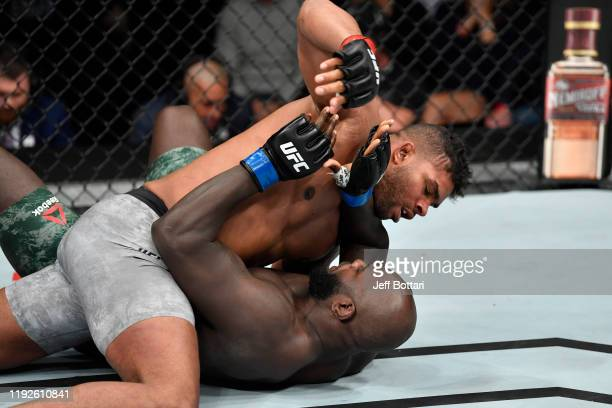 Alistair Overeem of Netherlands wrestles Jairzinho Rozenstruik of Suriname in their heavyweight bout during the UFC Fight Night event at Capital One...