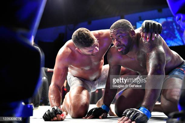 Alistair Overeem of the Netherlands consoles Walt Harris of the United States after their Heavyweight bout during UFC Fight Night at VyStar Veterans...