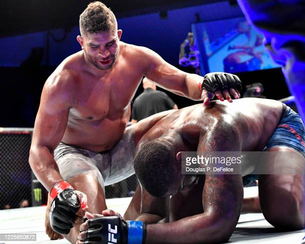 Alistair Overeem of the Netherlands consoles Walt Harris of the United States after defeating him in their Heavyweight bout during UFC Fight Night at...