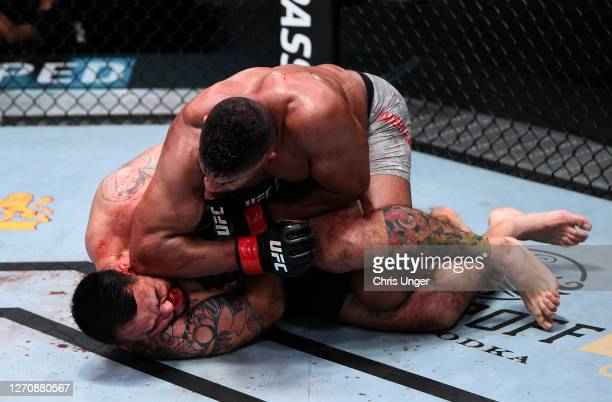 Alistair Overeem of the Netherlands elbows Augusto Sakai of Brazil in a heavyweight fight during the UFC Fight Night event at UFC APEX on September...