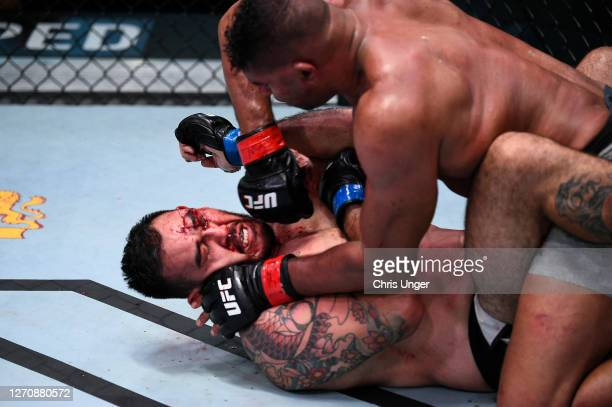 Alistair Overeem of the Netherlands punches Augusto Sakai of Brazil in a heavyweight fight during the UFC Fight Night event at UFC APEX on September...
