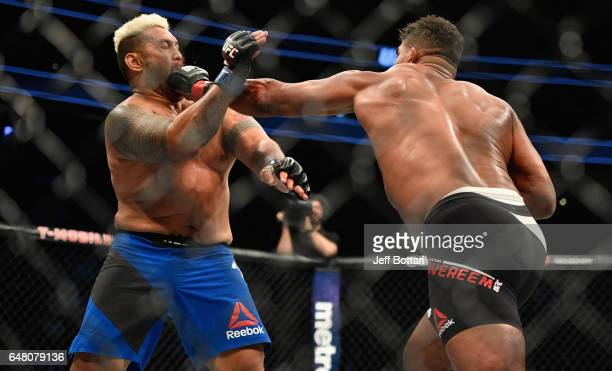 Alistair Overeem of the Netherlands punches Mark Hunt of New Zealand in their heavyweight bout during the UFC 209 event at TMobile Arena on March 4...