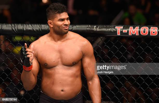 Alistair Overeem of the Netherlands reacts to his victory over Mark Hunt of New Zealand in their heavyweight bout during the UFC 209 event at TMobile...