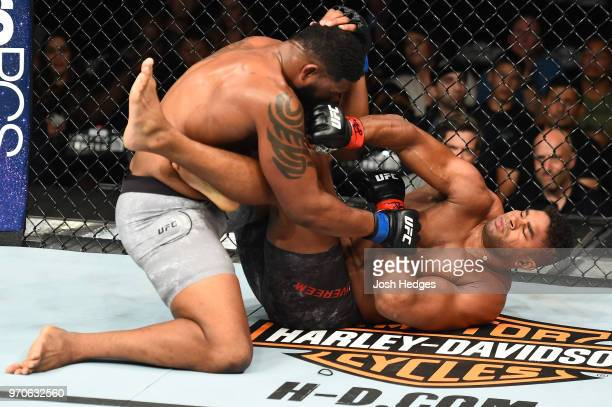 Alistair Overeem punches Curtis Blaydes in their heavyweight fight during the UFC 225 event at the United Center on June 9 2018 in Chicago Illinois