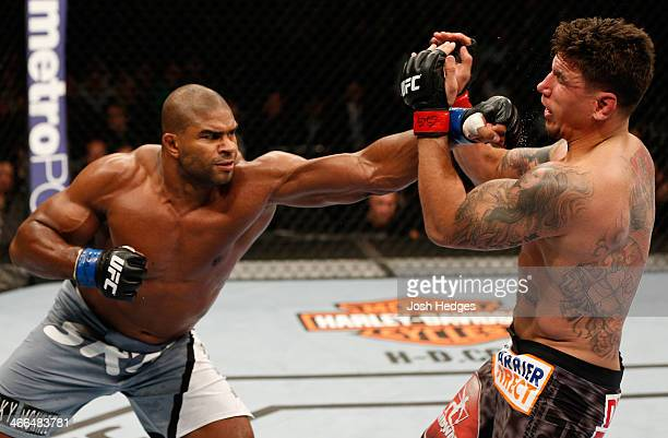Alistair Overeem punches Frank Mir in their heavyweight fight at the UFC 169 event inside the Prudential Center on February 1 2014 in Newark New...