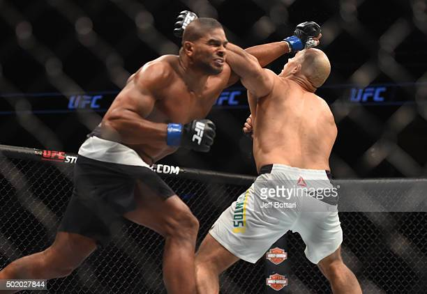 Alistair Overeem punches Junior dos Santos in their heavyweight bout during the UFC Fight Night event at the Amway Center on December 19 2015 in...