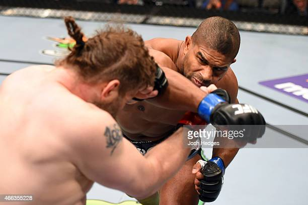 Alistair Overeem punches Roy Nelson in their heavyweight bout during the UFC 185 event at the American Airlines Center on March 14 2015 in Dallas...