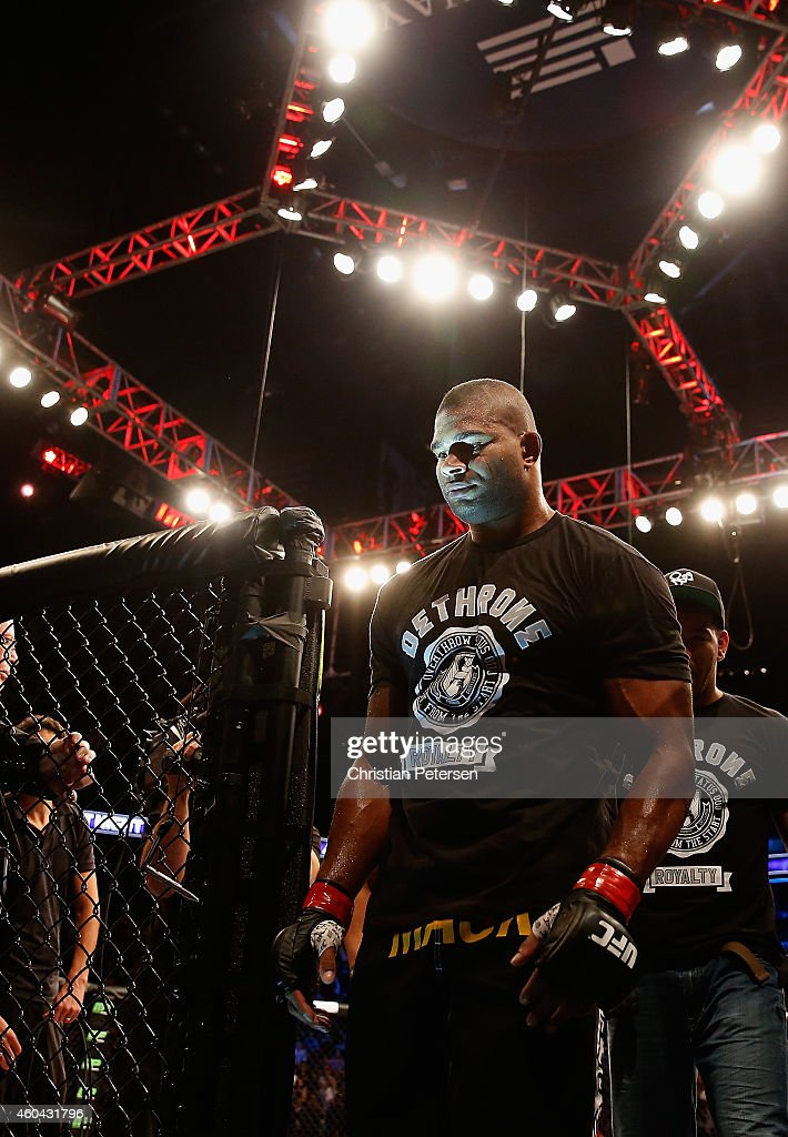 Alistair Overeem walks from the octagon after his ko victory over Stefan Struve (not pictured) in their heavyweight bout during the UFC Fight Night event at the at U.S. Airways Center on December 13, 2014 in Phoenix, Arizona.