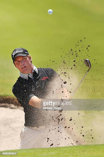 Alistair Presnell of Australia plays out of a bunker during day three of the 2015 Australian Masters at Huntingdale Golf Club on November 21, 2015 in...