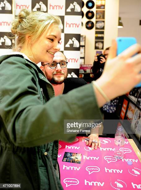 Alistair Testo of As It Is performs live and signs copies of their debut album 'Never Happy Ever After' at HMV on April 24 2015 in Manchester England