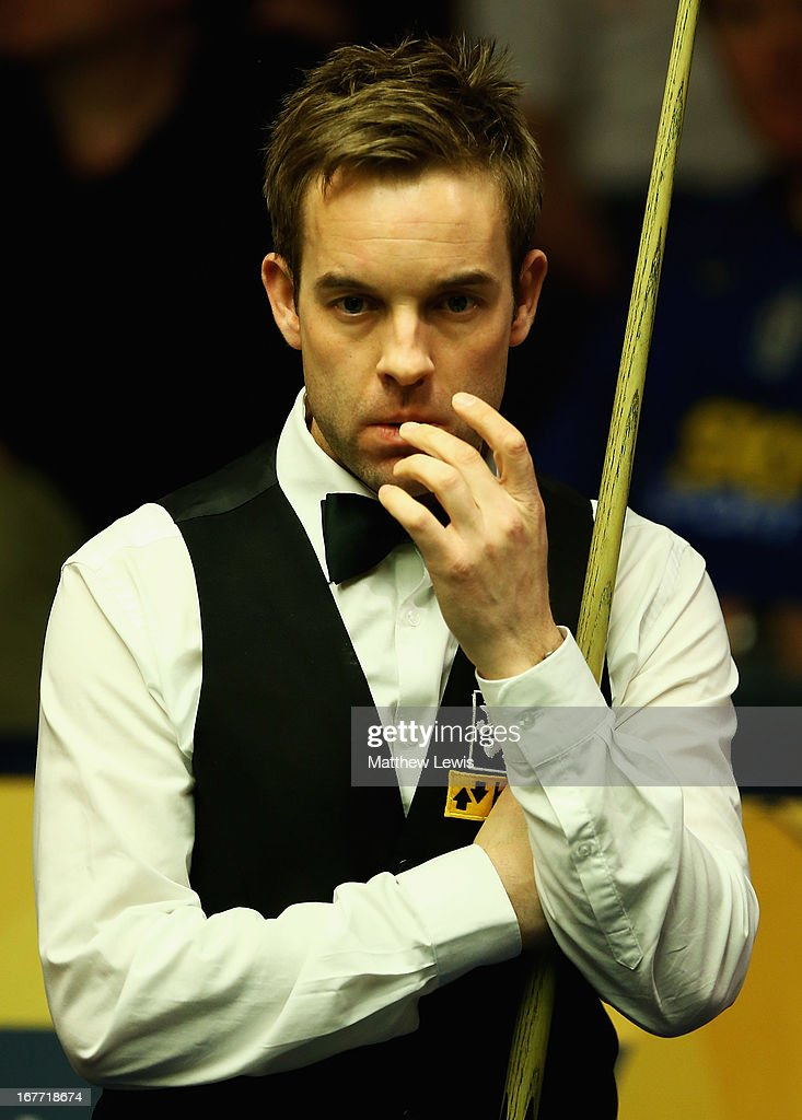 Alister Carter of Englandlooks on, during his match against Ronnie O'Sullivan of England during second round match of the Betfair World Snooker Championship at the Crucible Theatre on April 28, 2013 in Sheffield, England.