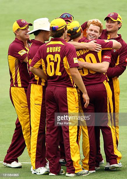 Alister McDermott of the Bulls is congratulated by team mates after taking his fifth wicket during the Ryobi One Day Cup match between the Western...